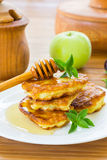 Pancakes with apples and honey Royalty Free Stock Images