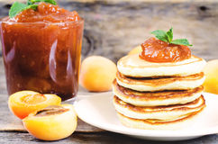 Pancakes with apricot jam Royalty Free Stock Image