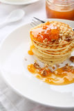 Pancakes with apricot jam Stock Photography