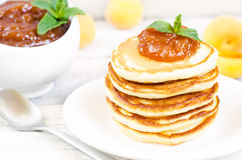 Pancakes with apricot jam Royalty Free Stock Images