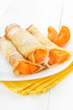 Pancakes with apricot slices Stock Photo