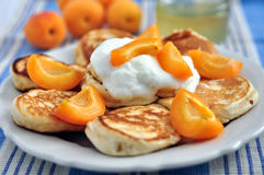 Pancakes with apricots Stock Images