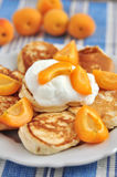 Pancakes with apricots Royalty Free Stock Photography