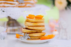 Pancakes with apricots and tangerines Stock Photos