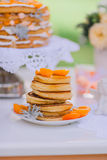 Pancakes with apricots and tangerines Royalty Free Stock Image