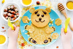 Pancakes for baby breakfast. Bear pancakes with honey and nuts - Stock Image