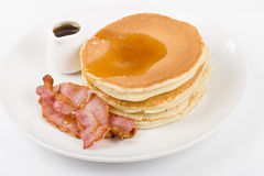 Pancakes, bacon and maple syrup Royalty Free Stock Photography