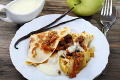 Pancakes with baked apples and vanilla sauce. Stock Photos