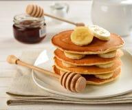 Pancakes with banana stock photos