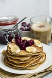 Pancakes with banana and berries stock photos