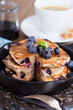 Pancakes with banana and blueberries Stock Photos