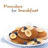 Pancakes with banana and blueberries, isolated Royalty Free Stock Photo