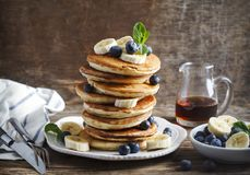 Pancakes with banana, blueberry and maple syrup. stock photos