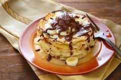 Pancakes with banana and chocolate Stock Photos