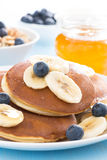 Pancakes with banana, honey and blueberry, close-up Royalty Free Stock Photography