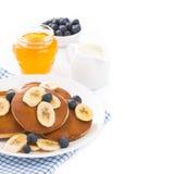 Pancakes with banana, honey, blueberry and yogurt for breakfast Stock Photography