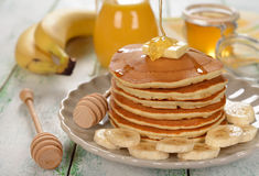 Pancakes with banana and honey Stock Photography