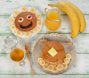 Pancakes with banana and honey Stock Images