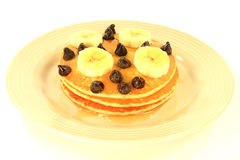 Pancakes Banana Maple syrup chocolate chips Royalty Free Stock Photo