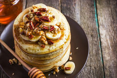 Pancakes with banana, nuts and honey Royalty Free Stock Photography