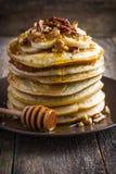 Pancakes with banana, nuts and honey Royalty Free Stock Photo