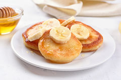 Pancakes with banana slices Stock Photography