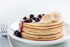 Pancakes with banana and syrup Royalty Free Stock Photo