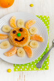 Pancakes with banana and tangerine for children. Top view Royalty Free Stock Photos