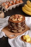 Chocolate pancakes with bananas on top stock images