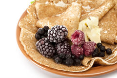 Pancakes with berries. Pancakes served with raspberries and blackberries stock photography
