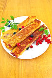 Pancakes with berries on the board Stock Photos