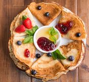 Pancakes with berries on breakfast Royalty Free Stock Photography