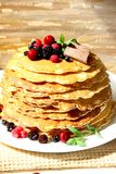 Pancakes with berries and chocolate. Sweet tasty pancakes with berrie fruits, chocolate and mint leaves Royalty Free Stock Images