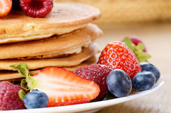 Pancakes with berries closeup Royalty Free Stock Photos