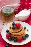 Pancakes with berries Stock Photos