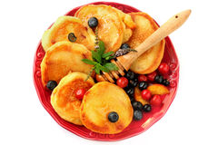 Pancakes with berries, fruits, honey on a plate isolated on white Stock Image