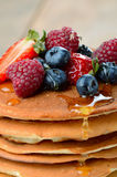 Pancakes with berries and honey closeup Stock Photography