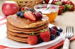 Pancakes with berries and honey closeup Royalty Free Stock Photography