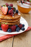 Pancakes with berries and honey closeup Royalty Free Stock Photos
