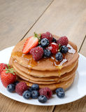 Pancakes with berries and honey closeup Stock Photo
