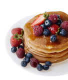 Pancakes with berries and honey over white Stock Photography