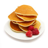 Pancakes with berries isolated on white Stock Images