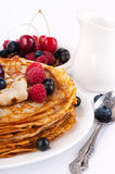 Pancakes with berries and jug Royalty Free Stock Photography