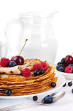 Pancakes with berries and jug Royalty Free Stock Photo