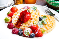 Pancakes with berries and maple syrup Stock Photos