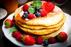 Pancakes with berries and maple syrup. Some Pancakes with berries and maple syrup stock images