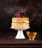 Pancakes  with berries and maple syrup Stock Images