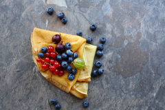 Pancakes with berries on slate. Food top view Royalty Free Stock Images