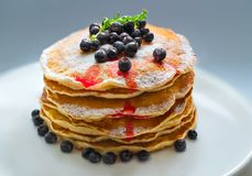 Pancakes with berries and sugar stock photos