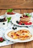 Pancakes and berries Stock Photos